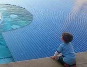 Kid staring into pool window